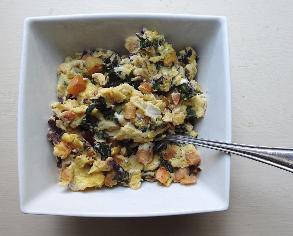 Recipe: Egg Scramble With Summer Squash And Beet Greens