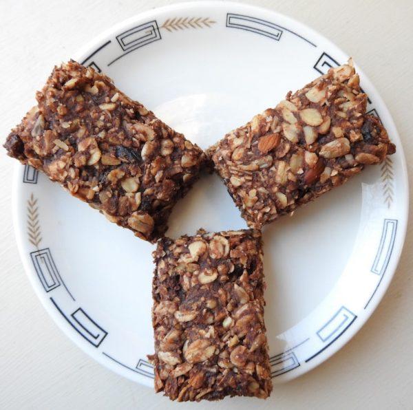 three homemade granola bars on a plate